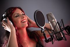 happy woman singing studio